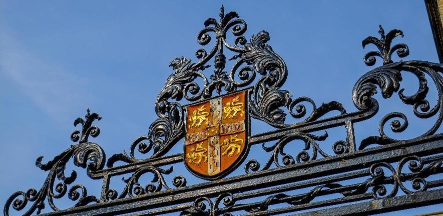 University crest against a blue sky
