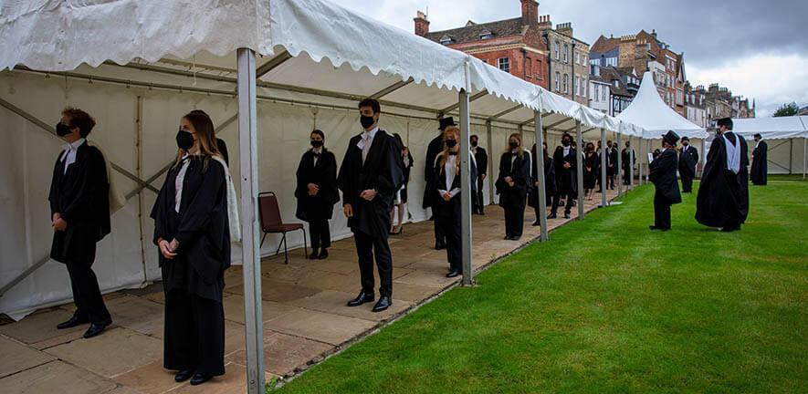 Socially-distanced students lined up to receive their degree in General Admission