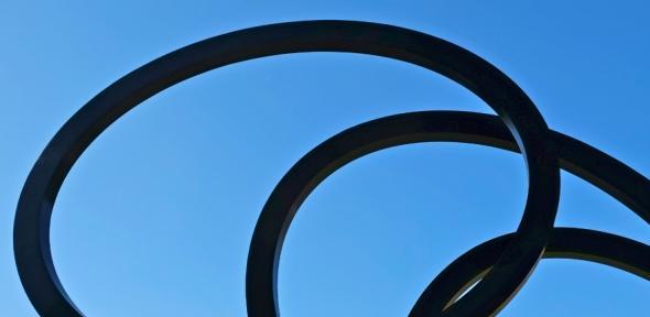 A sculpture against a blue sky