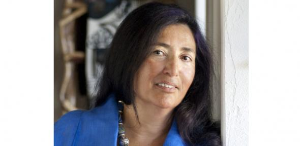 Professor Mary Romero in a blue shirt